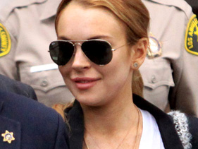 aab30b015581x211.jpg Lindsay Lohan Moves Into House Next To Ex Samantha Ronson