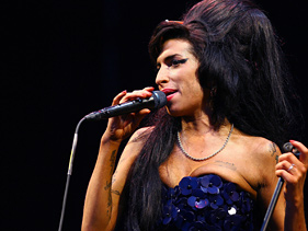 779725ba0281x211.jpg Amy Winehouses Music Sales Spike